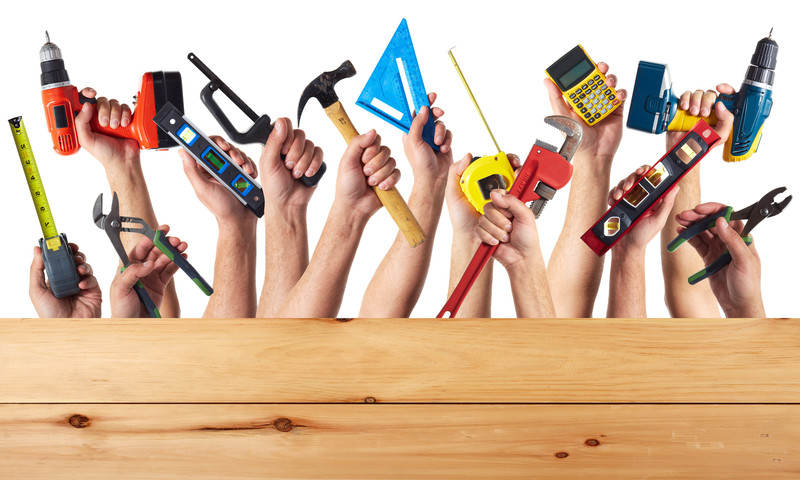 diy hands holding tools